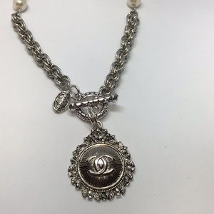 Timeless Authentic Chanel button necklace piece.